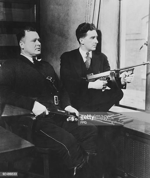 Two extra guards armed with a shotgun and a machine gun stationed at Lake County Jail in Crown Point Indiana 1934 They are fearful of an escape...