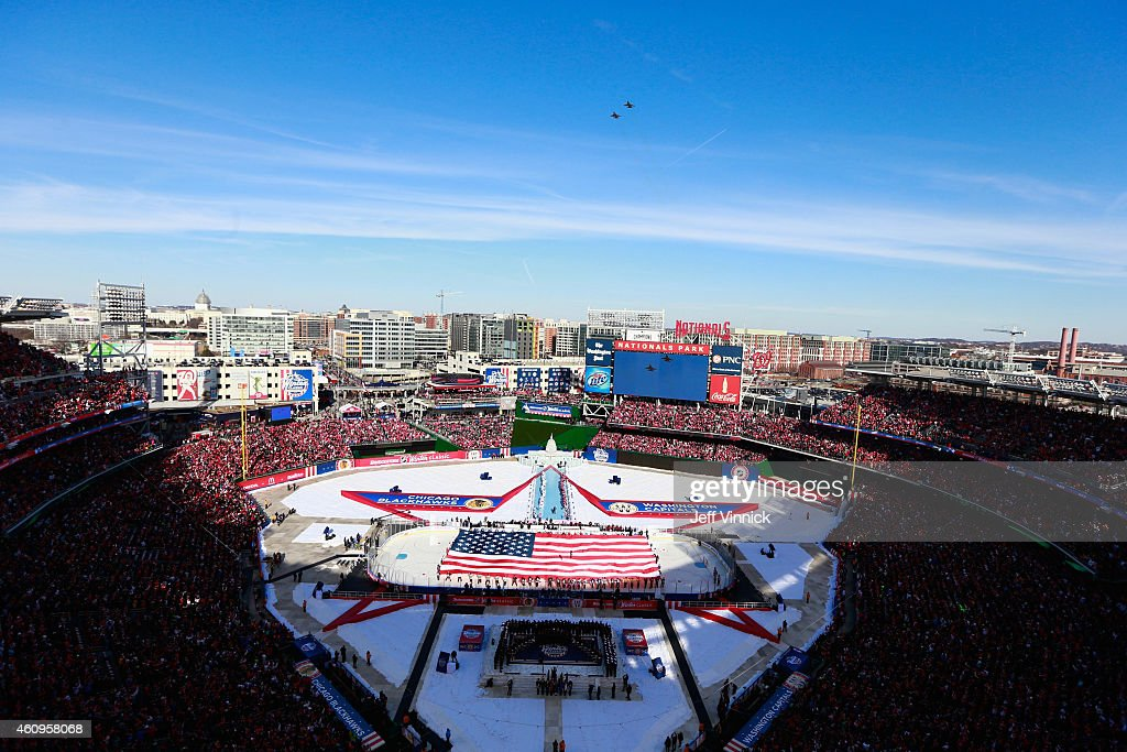 Two F16's perform a fly over at the start of the 2015 Bridgestone NHL Winter Classic between the Washington Capitals and the Chicago Blackhawks on...