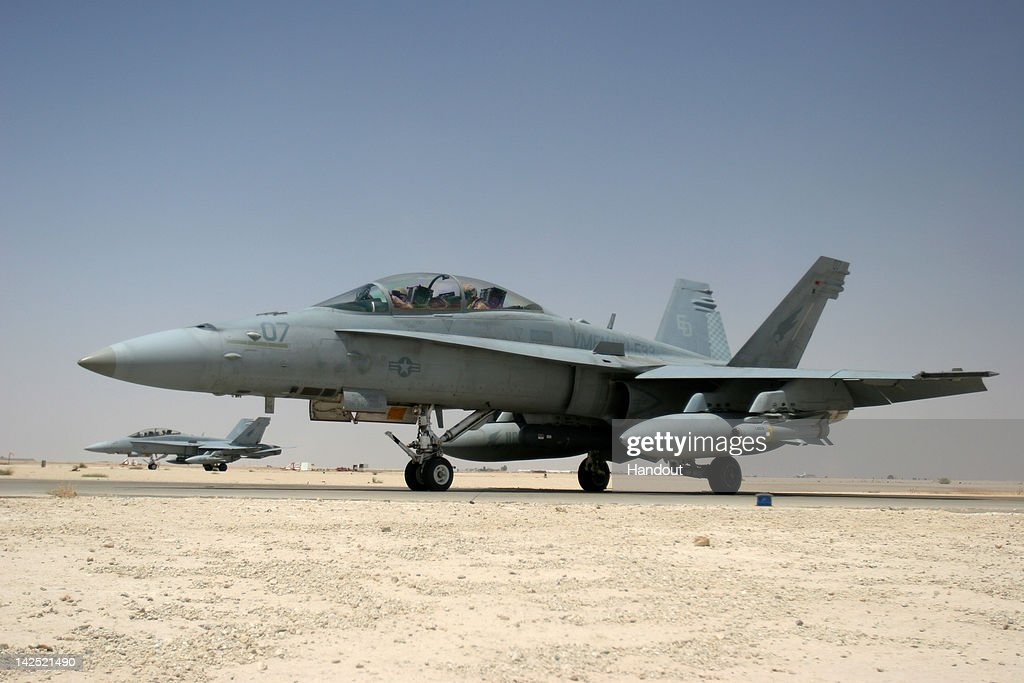 Two F/A-18D Hornets, assigned to the 'Knighthawks' of Marine Fighter Attack Squadron Five Three taxi on the flight line July 5, 2005 in Al Asad, Iraq. According to reports April 6, 2012, a U.S. Navy F/A-18D jet crashed into an apartment complex in a residential neighborhood of Virginia Beach, Virginia. Six people, including the two U.S. Navy pilots who ejected, have been hospitalized.