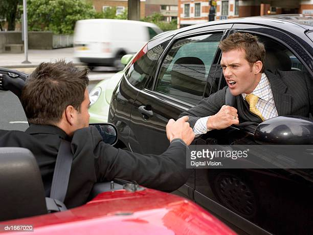 Two Face to Face Businessmen Driving Their Cars Threatening One Another