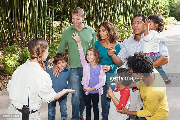 Two families at a park with guide