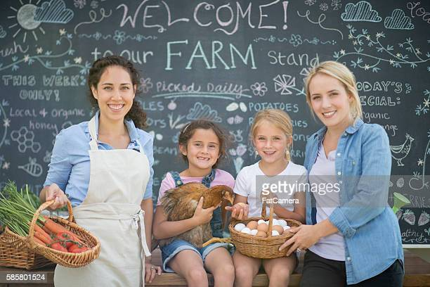 Two Families Selling Food From Their Farm