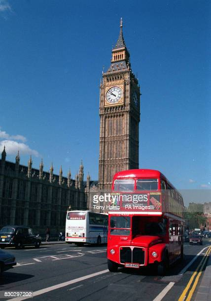 Two famous sites of London brought together Big Ben and a London red doubledecker bus making its way over Westminster Bridge 02/12/02 London...