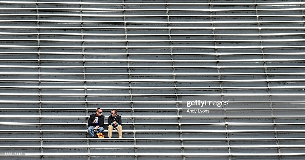 Two fans have plenty of room to themselves while attending the Mississippi State Bulldogs game against the Kentucky at Commonwealth Stadium on October 6, 2012 in Lexington, Kentucky.