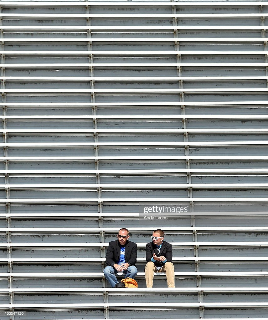 Two fans have plenty of room to themselves while attending the Mississippi State Bulldogs game against the Kentucky Wildcats at Commonwealth Stadium on October 6, 2012 in Lexington, Kentucky.