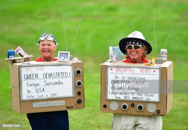 Two fans look on during the final day singles matches of The Solheim Cup at Des Moines Golf and Country Club on August 20 2017 in West Des Moines Iowa