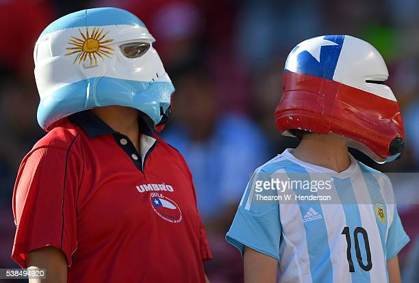 Two fans looks on from the stands prior to the start of the game during the 2016 Copa America Centenario Group match play between Argentina and Chile...