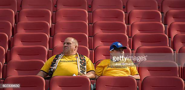 Two fans of Dresden are seen prior to the Second Bundesliga match between Hannover 96 and SG Dynamo Dresden at HDIArena on September 11 2016 in...
