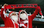 Two fans of Koeln wear Santa Claus dresses during the Bundesliga match between 1 FC Koeln and FC Augsburg at RheinEnergieStadion on December 6 2014...