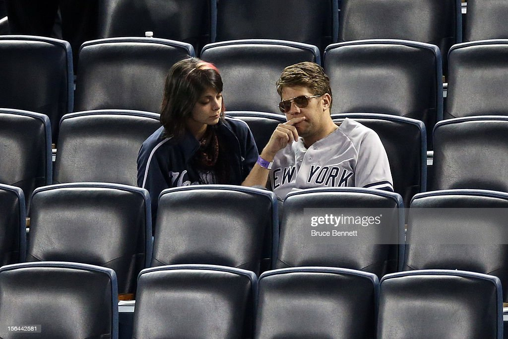 Two fans of the New York Yankees look on dejected after the Yankees lost 3-0 against the Detroit Tigers during Game Two of the American League Championship Series at Yankee Stadium on October 14, 2012 in the Bronx borough of New York City.