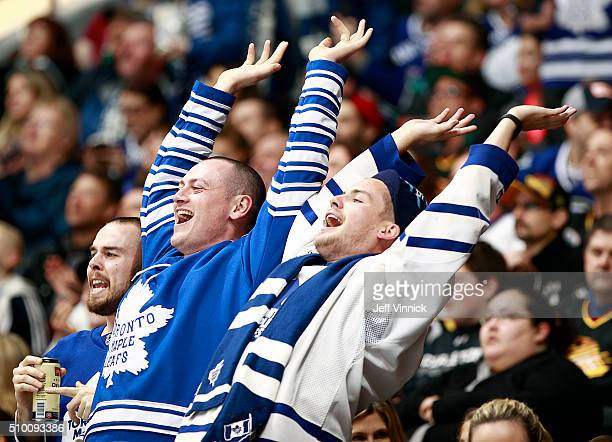 Two fans of the Toronto Maple Leafs celebrate a goal against the Vancouver Canucks during their NHL game at Rogers Arena February 13 2016 in...