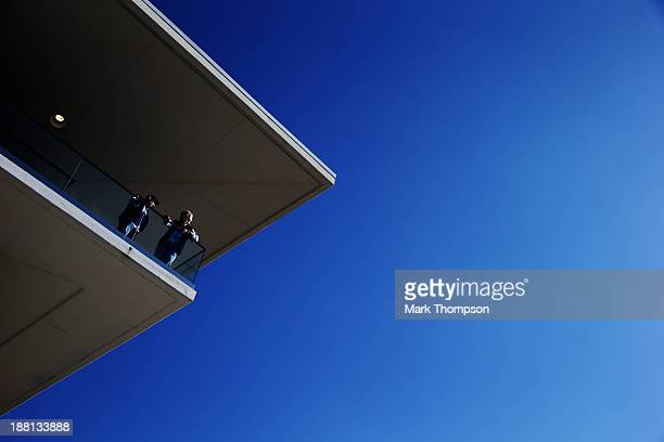 Two fans watch from the paddock club during practice for the United States Formula One Grand Prix at Circuit of The Americas on November 15 2013 in...