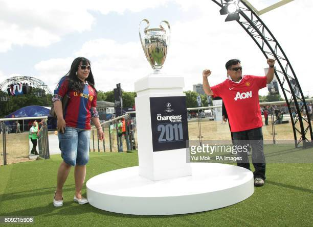 Two fans wearing shirts of the finalists Manchester United and Barcelona during the official opening of the UEFA Champions Festival at Hyde Park in...