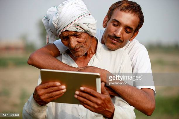 Two farmer using ipad