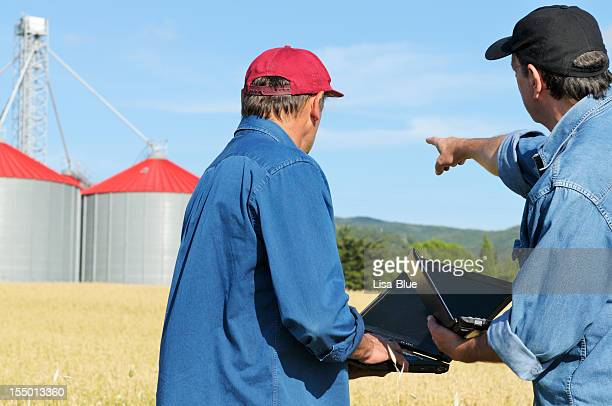 Two Farmers Planning PC in the Countryside
