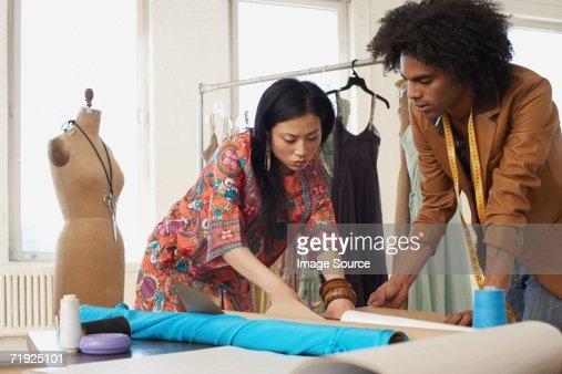 Two fashion designers working