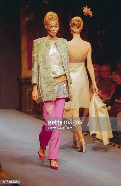 Two fashion models wear women's haute couture fashions during a 1997 springsummer fashion show for French fashion designer Christian Lacroix To the...