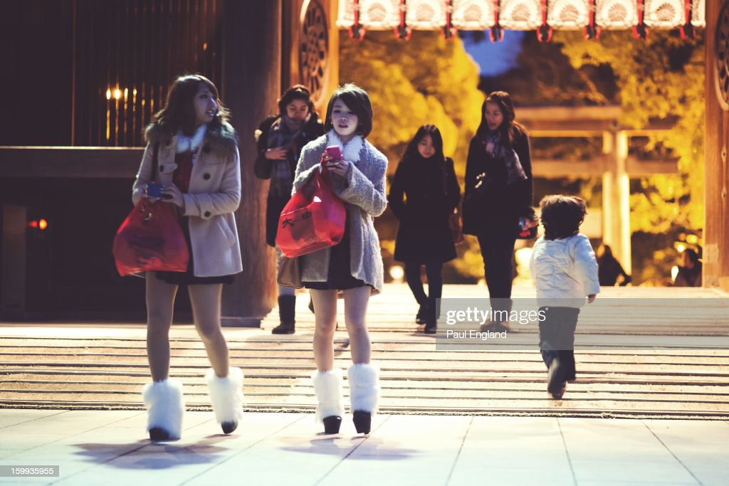 CONTENT] Two fashionable girls wearing leg warmers show up to pay their respects at Meiji Shrine on New Years' Eve.