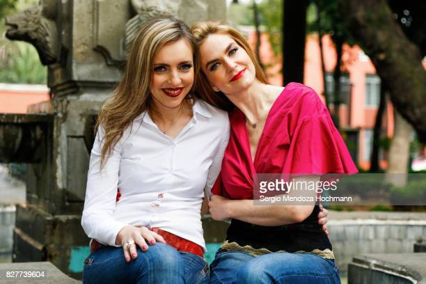 Two fashionable mid adult women in Mexico City in front of a fountain