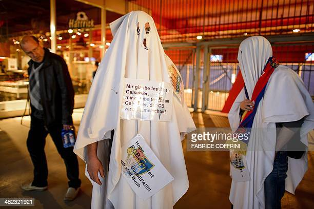 Two FC Basel fans disguised as ghosts leave St Jakob Stadium prior to the UEFA Europa League quarterfinal first leg football match FC Basel vs...