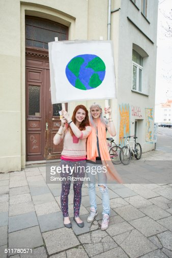 Participant Photography Holding Protest >> Two Female Activists Demonstrating With Banner Stock Photo | Getty Images