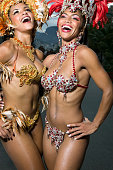 Two female carnival dancers smiling