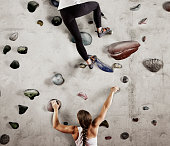 Two female climbers on climbing wall
