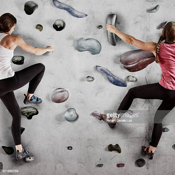 Two female climbers on indoor wall