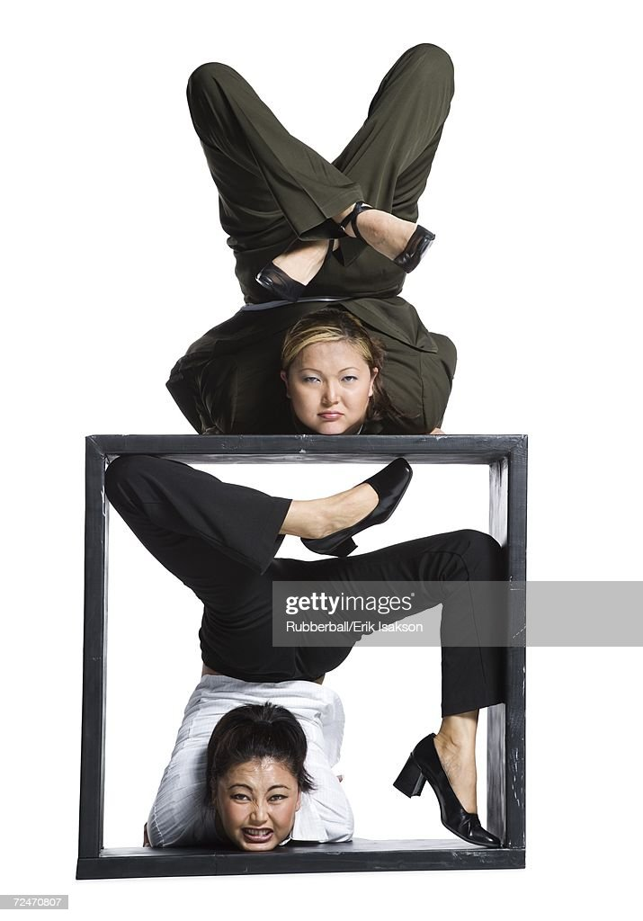 Two female contortionist businesswomen : Stock Photo