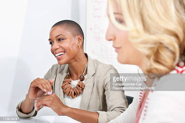 Two female designers in a meeting.