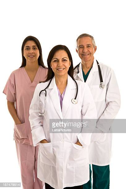 Two female doctors, one male doctor, scrubs and lab coat