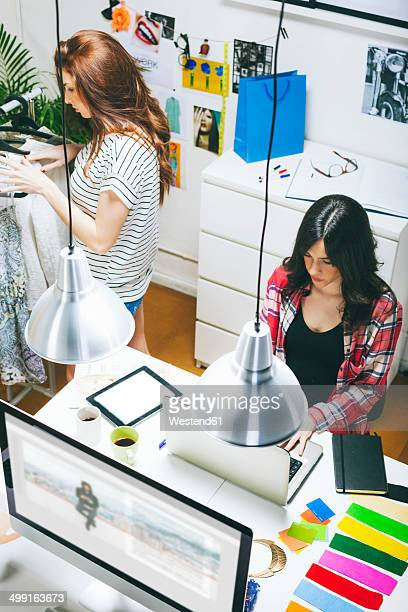 Two female fashion bloggers working in the office, elevated view