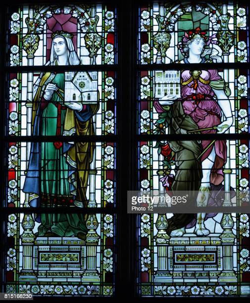 Two female figures possibly representing Mathematics depicted in a stained glass window at the Rijks Museum in Amsterdam Holland