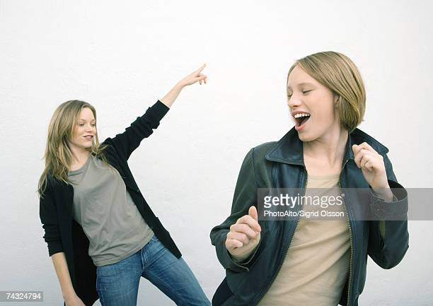 Two female friends dancing