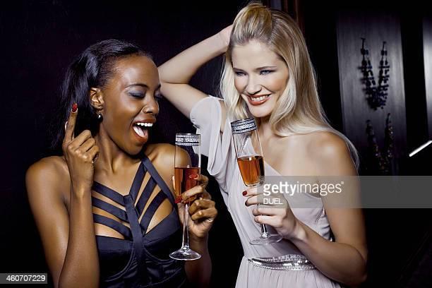 Two female friends having fun in nightclub