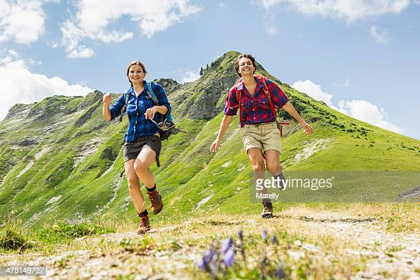 Two female friends running, Tyrol, Austria