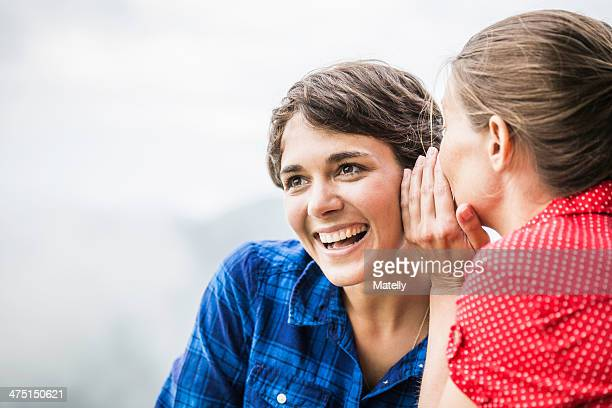 Two female friends sharing secret, Tyrol Austria