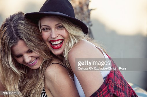 Two female friends smiling, portrait