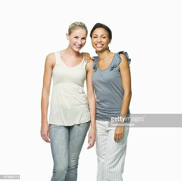Two Female Friends Standing Together - Isolated