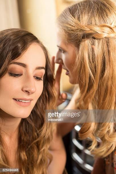 Two female friends talking in a coffee shop
