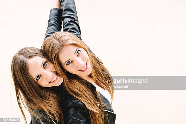 Two female friends wearing black leather jackets