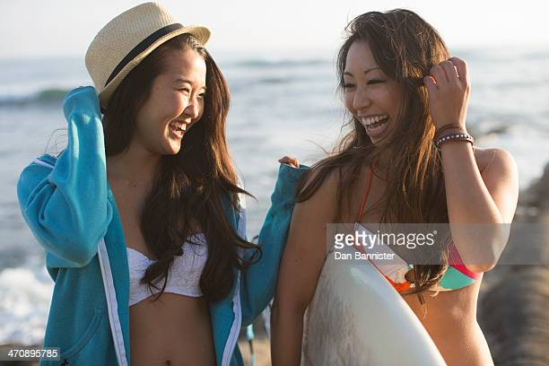 Two female friends with surfboard, San Diego, California, USA