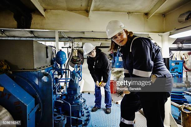 Two female naval architects performing inspection
