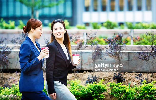 Two female office workers walking to work
