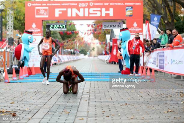 Two female participants finish 42km run within the Vodafone 39th Istanbul Marathon in Istanbul Turkey on November 12 2017 It is the only course in...