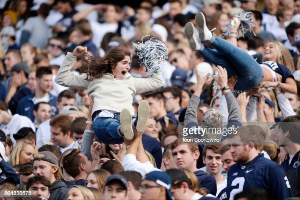 Two female Penn State fans in the student section are lifted and thrown in the air after a touchdown The Penn State Nittany Lions defeated the...