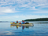 Two female sea kayakers, San Juan Islands, Washington State, USA