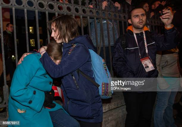 Two female seen comforting each other during an unauthorized rally The President of Russia Vladimir Putin celebrated his 65th birthday today To mark...