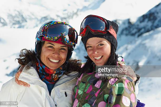 Two Female Skiers Standing On Bansko Mountains
