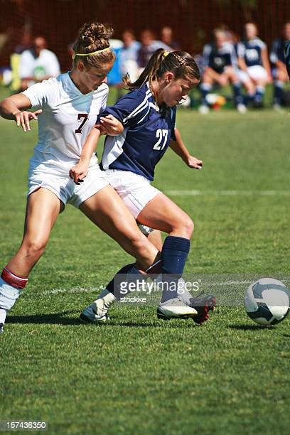 Two Female Soccer Players in Arm and Foot Tangle